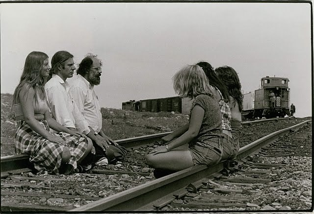 derrierelasalledebains:  Allen Ginsberg, Peter Orlovksy and fellow meditators, blocking the supply rail for Rocky Flats nuclear weapons production facility, Jefferson County, Colorado, June 1978. photo c. Joe Daniel