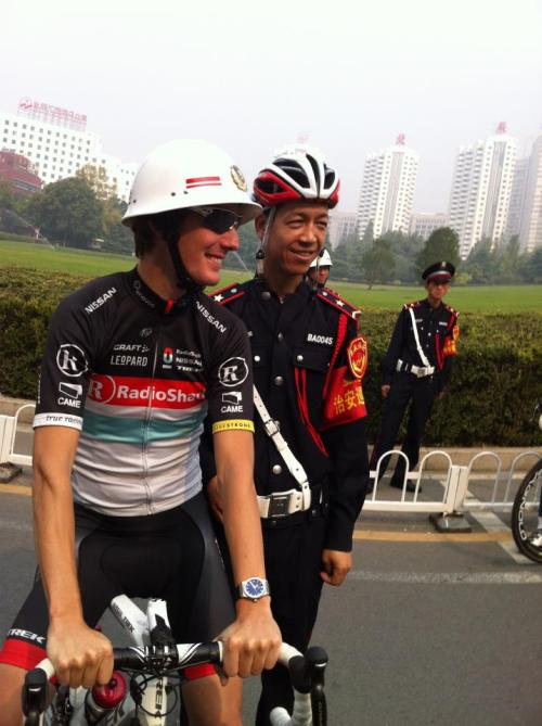 Tour of Beijing: Andy Schleck trying out his new racing helmet before training this morning. The guy next to him like it. (via Wall Photos)