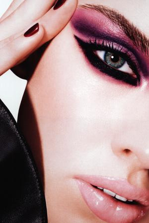 Dramatic purple pink and black eye makeup with glossy pink lipstick