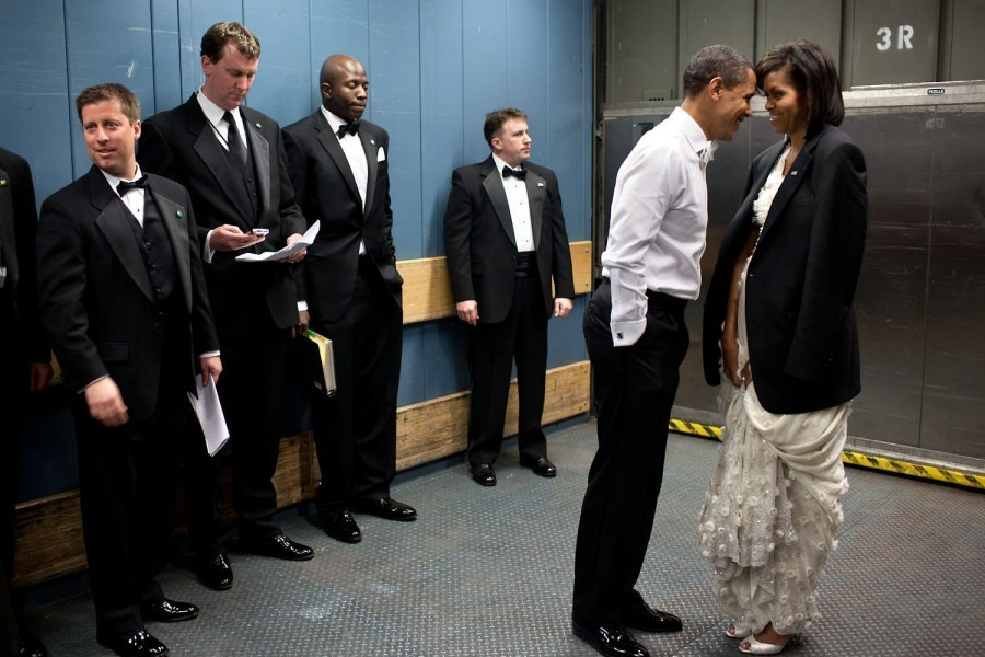 """We were on a freight elevator headed to one of the Inaugural Balls on Jan. 20, 2009. It was quite chilly, so the President removed his tuxedo jacket and put it over the shoulders of his wife. Then they had a semi-private moment as staff member and Secret Service agents tried not to look.""  —Pete Souza In a TIME exclusive, Chief White House photographer Pete Souza offers his personal edit and recollections on President Obama's first term. See more photos here."