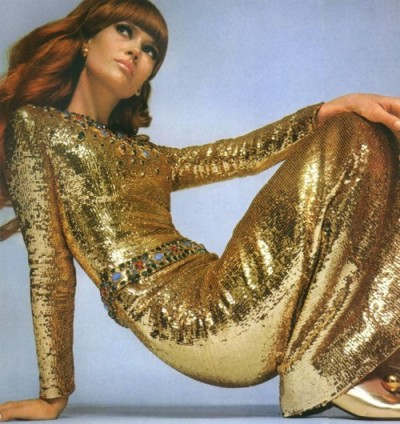 theswinginsixties:  Model wearing a gold gown by Yves Saint Laurent for Vogue Paris, 1967. Photo by David Bailey.