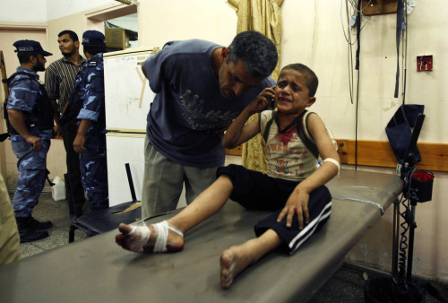 "palestinianliberator:  reuters:  A wounded Palestinian boy speaks on the phone with his family following an Israeli air strike in Rafah camp in the southern Gaza Strip October 7, 2012. A missile fired by an Israeli aircraft hit and wounded two Palestinian militants and eight bystanders in the southern Gaza Strip on Sunday, Palestinian hospital officials said. [REUTERS/Ahmed Zakot] REUTERS PHOTOS: The most-compelling images from the past 24 hours  You hear all the time people exclaiming how the number of people ""injured"" doesn't matter, it's the death toll that does, and that Israel shouldn't be berated for the number of people caught in the crossfire as long as they make it out alive ""because they try their best to limit civilian casualties"" Well here's the thing-Can you imagine the stress and trauma this boy will face for the rest of his life as a result of his ""minor"" wounds? Could you imagine this happening to your brother or sister? To yourself? Always having to worry about when the next attack will come, and from where, with no hope for escape or release? Sure, it's just a ""little bit of blood"". How many children are even exposed to blood outside of a scraped knee, though? Let alone a full on missile explosion. Could you imagine the uproar if this was what American citizens traveling abroad were subjected to? The media outcry, the protests, the films, the books, the interviews and the campaigns that would come out of it if a grain of sand were to be projected too forcefully into the skin of an American and draw blood due to some blast in the Middle East, let alone if it had been an American Child? This is supposed to be ""normal"" for us, as we're chastised by people sitting comfortably in their La-Z-Boy sofas typing away on their laptops about the ""Collateral damage"" that inevitably comes with bombing people to freedom"