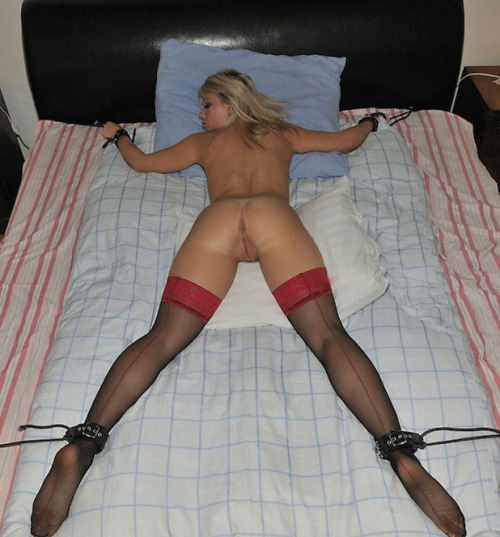 Tied up wife spread eagle on bed