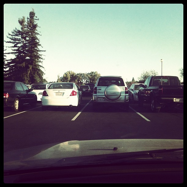 It's #monday. Today's #parking :). #parkinglot #parkinglothangout 9am class got cancelled,don't have class till 10:30,it's 7:59. 😒😞. I'm almost out of gas and gas will cost me my first born. I don't know how far I'll be able to make it and its making me panic 😖😖😖😭😭😭. Ironcially wearing my #dontpanic shirt. Ha ha ha HA. Fuck today. I just wanna go home,curl up in my bed,listen to music,& fucking cry. #emotions #crap #ugh #music  (Taken with Instagram at Stadium Parking)