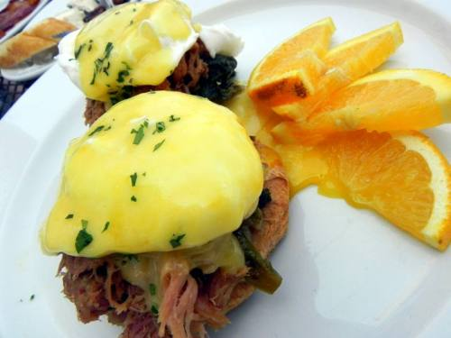 Smoked Pork Benedict with poached eggs and braised mustard greens, biscuits and Hollandaise from Dijon Restaurant