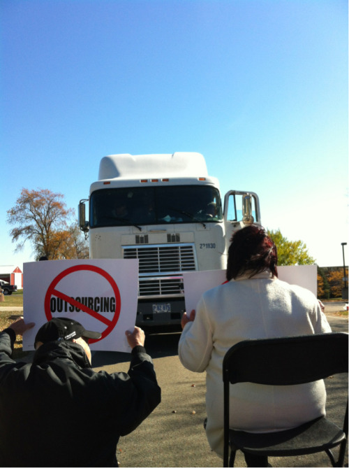 Community supporters are blocking the equipment. The truck driver tried to run them over.