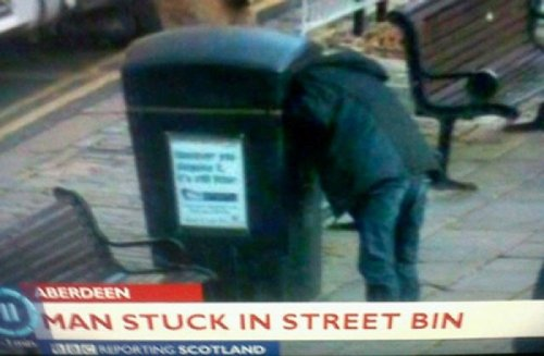 Breaking News: Man Stuck in Trash Can In other news, man thinks he's a cat.