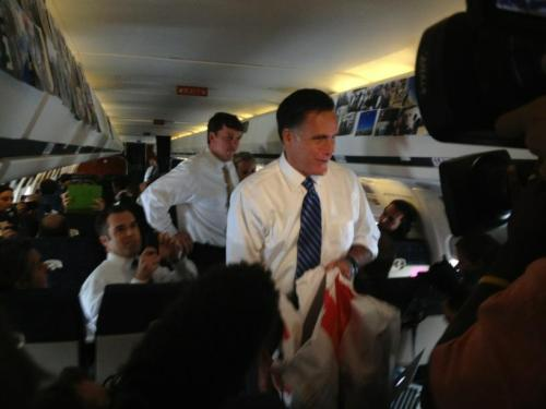 Mitt Romney visits the press passing out McDonald's: Quarter Pounder? (Photo taken by Sarah Huisenga, CBS News & National Journal)