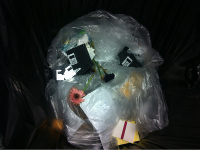 Objects found within refuse bin.