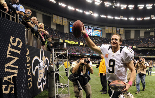 gq:  Ugliest loss of Week 5? Your memory of Drew Brees's record. So Drew Brees broke the hallowed Consecutive Games With a Touchdown Pass record, and NBC played it up to the best of their abilities. They cut to Johnny Unitas's son Joe in the crowd, who had HUGE hands, like someone stuffed a catcher's mitt under the skin of his palms. And they cut to Brees's family in the luxury suite, and Sean Payton attending the game in a one-time conjugal visit. And they had Michele Tafoya remarking breathlessly on where the record-breaking ball was stashed. (SPOILER: They put it in a box!) They did everything possible to make it a memorable moment, and it wasn't. No one really cares about that shit. A month from now, you won't be able to remember who owns this record, and you won't care, because caring about records is for other, douchier sports. The Ball Baron on Week 5