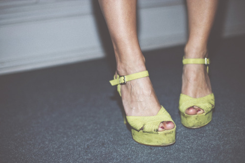 she danced in her green atmosphere heels.