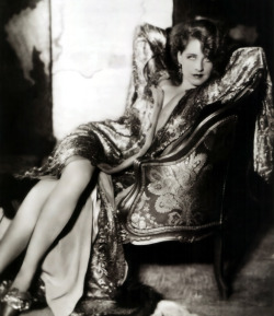 ricksginjoint:  Norma Shearer wears a kimono dress designed by Gilbert Adrian, photographed by George Hurrell (c1930)
