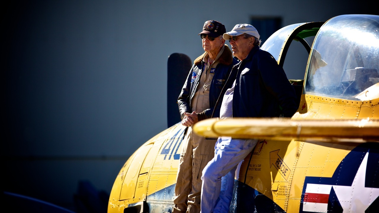 A couple of old pilots share stories during Fleet Week.