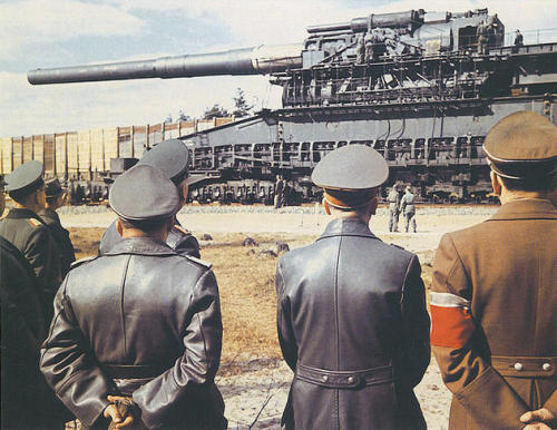 "Hitler inspecting the massive 800mm ""Schwerer Gustav"" railway gun from afar. It was the largest-calibre rifled weapon ever used in combat, and fired the heaviest shells of any artillery piece."