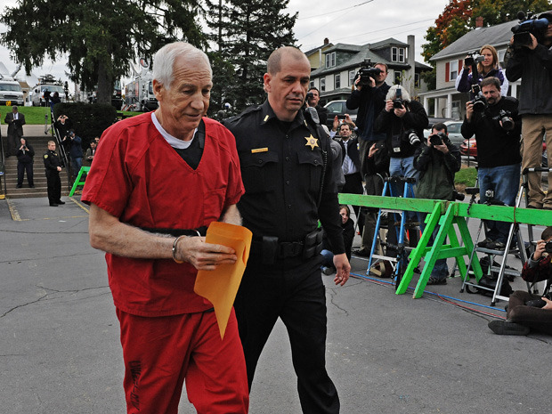"Jerry Sandusky blames victims in broadcast before sentencingThe ex-Penn State coach professed his innocence and vowed to continue fighting his child molestation conviction in a recorded statement broadcast on the eve of his sentencing Tuesday, a possible preview of remarks he was expected to make at the hearing.In the three-minute monologue aired Monday night by Penn State Com Radio, Sandusky said he knows in his heart that he did not do what he called ""these alleged disgusting acts"" and described himself as the victim of Penn State, investigators, civil attorneys, the media and others.""They can take away my life, they can make me out as a monster, they can treat me as a monster, but they can't take away my heart,"" he said. ""In my heart, I know I did not do these alleged disgusting acts. My wife has been my only sex partner and that was after marriage.""A thinner Sandusky, smiling and accompanied by sheriff's deputies, showed up at the courthouse Tuesday wearing a red prison jumpsuit, white sneakers and holding a manila envelope."
