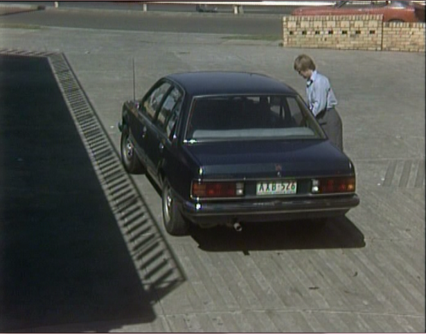 Meg and her Commodore.  My first car was the same, but in PCBH, this car at the time was only about 3 years old.