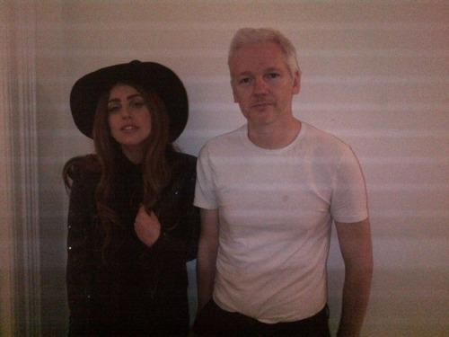 We were just thinking it would be so nice if Lady Gaga and Julian Assange came out of their shells a little and tried to get some gosh darn attention for once, so it's nice to see that the two of them found one another. We just hope that Julian doesn't throw some water on Gaga in that outfit, lest she melt.