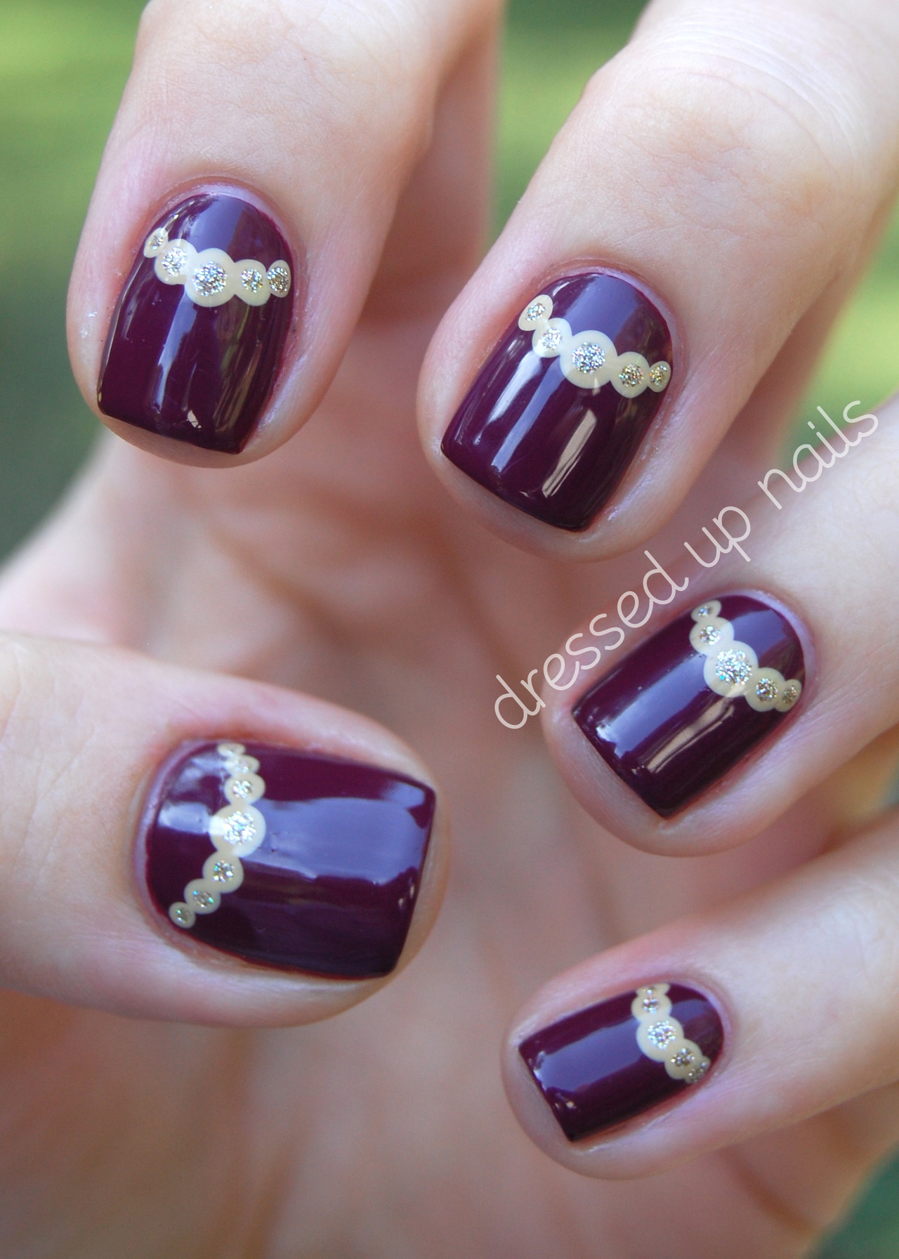 dressedupnails:  Today I have the second installment in my China Glaze On Safari nail art series, which isn't a series so much as an excuse to use only colors from this collection for a while because I am so deeply in love with all of them. I think it looks like my nails are wearing little necklaces! Classy lil things. Read more and see more pics on the ol' blog! (also, did you know I'm on Facebook?)