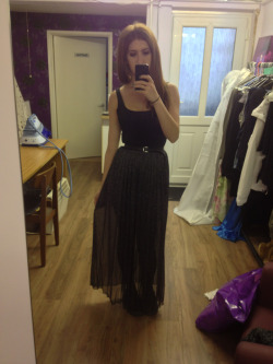 What I wore today  Metallic sparkly maxi skirt  Black vest  Black and silver belt  Black converse