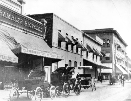 The Rambler bicycle and automobile shop in downtown L.A. at Fifth and Spring streets, circa 1902. Part of the Title Insurance and Trust / C.C. Pierce Photography Collection in the USC Digital Library.