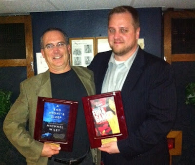 Our very own Duane Swierczynski with fellow Shamus Award winner Michael Wiley (via The Rap Sheet—photo © 2012 Ali Karim). More on Duane's FUN AND GAMES here.