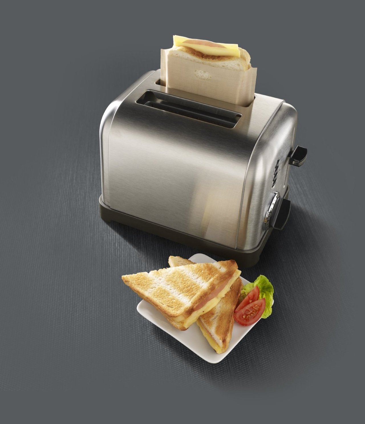 This glorious invention allows you to make a grilled cheese with only your toaster and no mess.  Let's say it all together now: HOLY SHIT. My money couldn't have been spent faster.