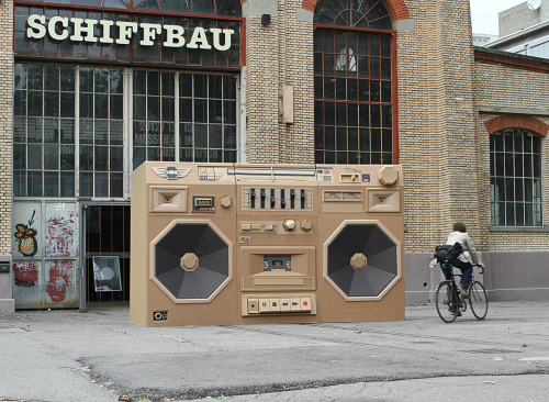 Cardboard Boombox by Bartek Elsner To promote International Radio Festival in Zurich, this giant cardboard ghetto blaster is secretly hiding a Mini inside which actually acts as a battery and powers the speakers to produce sound.  Artists: | Behance | Website |