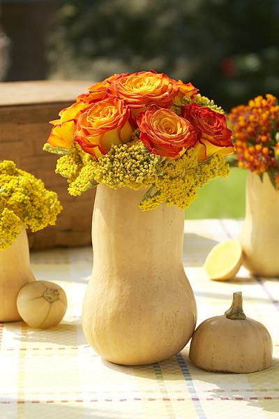 Welcome the new season with nature-inspired Fall decorations like these beautiful flower arrangements placed inside hollowed-out squash!