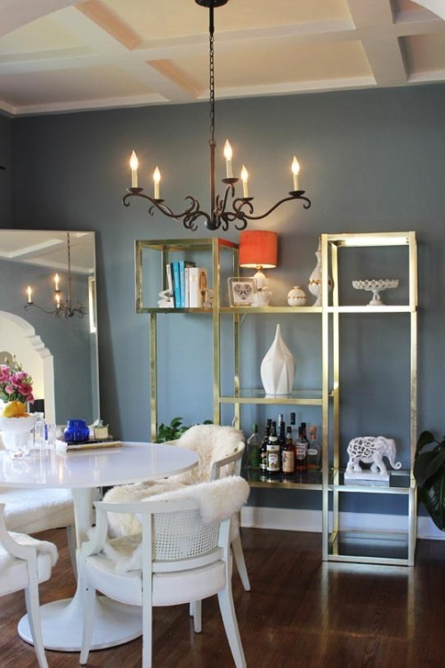 The gold shelving against the dark walls is beyond romantic. This room has stolen our hearts! {image}