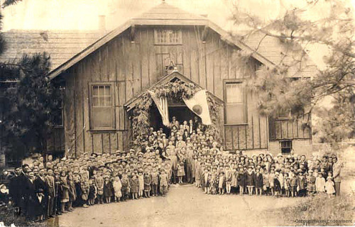 The Hood River Nikkei community is shown gathered in front of the Japanese Community Hall in 1929, commemorating Japanese Ambassador Debuchi's visit.