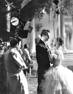 Director William Wyler shooting a scene between Henry Fonda and Bette Davis in Jezebel (1938)