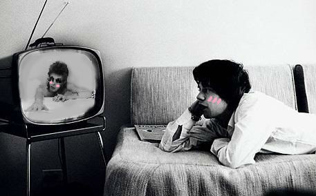 moodyandgrey:  Mick Jagger watching David Bowie on TV, wishing he would come out of the screen.