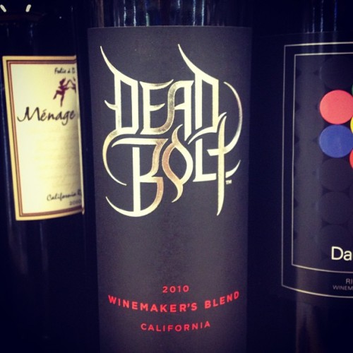 "3hree Things: Deadbolt Wine a) surprised it's not a 2002 vintage b) surprised it doesn't have the stereotypical early 2000's era distressed-Helvetica ""hardcore"" font (That goth business is wack.) c) wouldn't be surprised if at tastings for the winery, guests yelled out ""Deadbolt"" every time an alternative wine was introduced. (Taken with Instagram)"