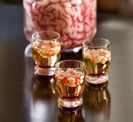 Bloody Brain - mix 1 1/4 oz vodka and 1/8 oz lime juice and add to shot glasses to fill to about 3/4 full. Slowly add cream liquor to form brain. Drizzle grenadine.
