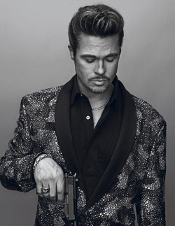 gasstation:  Brad Pitt photographed by Steven Klein for Interview, November 2012  Is it me, or does Brad Pitt look kind of super-excellent as the overt mafia boss? He looks a bit bemused about the handgun, too, which is just making the whole character take on life in my mind… I'm sure that sequin job is state-of-the-art hand designed or sewn or something, because you don't get that kind of patterning from a machine sewing on sequins. I'm not a fan of sequins, but it makes me want to like them here. I definitely like that black pleated blouse.