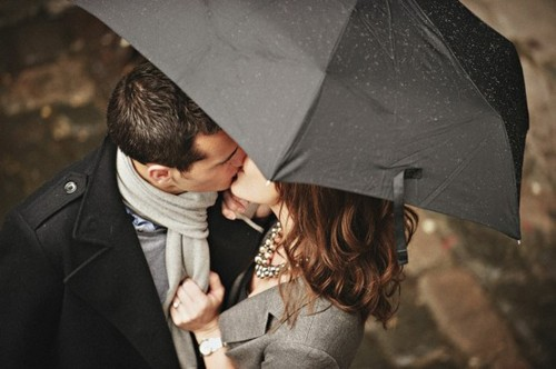 The first time my husband kissed me it had just started raining and we didn't have an umbrella…but we didn't care :). (Smoochies, sweetie!)