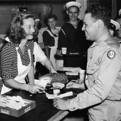 "70 years ago the Hollywood Canteen opened at 1451 Cahuenga Boulevard. Bette Davis served as President of the Canteen, which provided free entertainment to nearly 3 million servicemen during World War II. Reflecting on the opening night she said,""It seemed thousands of men entered the canteen that night. I had to crawl through a window to get inside."" Information taken from The Bette Davis Estate… http://www.facebook.com/BetteDavis"