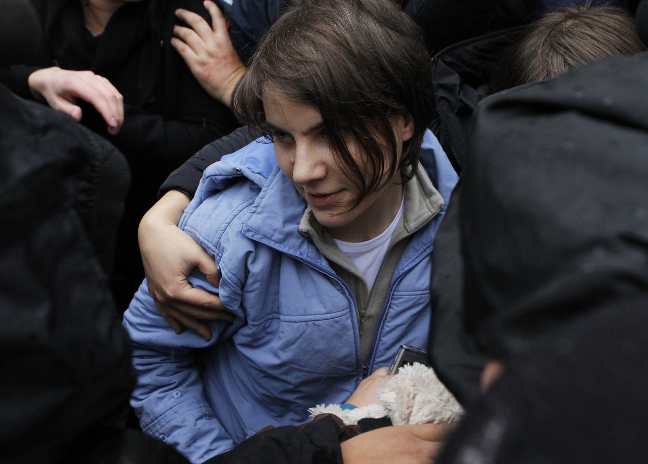"A member of punk band Pussy Riot was freed on appeal on Wednesday but a Moscow court upheld prison sentences for two others imposed over a raucous cathedral protest against Vladimir Putin, who said they had got the jail terms they deserved. Yekaterina Samutsevich walked free from Moscow City Court after six months behind bars but the appeal judge who suspended her two-year sentence said fellow band members Nadezhda Tolokonnikova and Maria Alyokhina should serve out their terms. ""I have mixed feelings,"" Samutsevich, 30, said outside the court, where she was greeted by applause and whistles from a crowd of about 150 people in the rain. ""I'm happy, of course, but I am upset about the girls."" READ ON: One Pussy Riot member freed on appeal by Russian court"