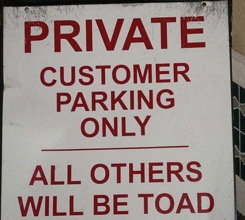 Parking Here Will Turn You Into a Frog Well, at least you won't have to get your car out of compound.