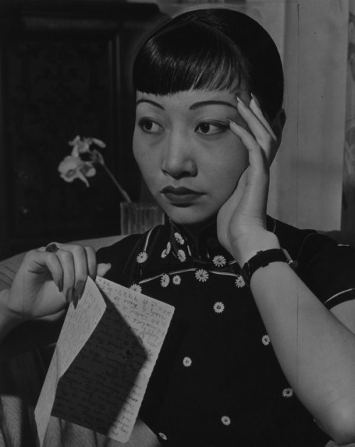 "softfilm:  ""Anna May Wong, Chinese Film star, received a $20,000 threat letter. She sits, holding the letter which threatened her with disfigurement."" (March 25, 1937) Courtesy of the Los Angeles Public Library"