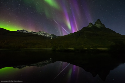 One night in mid-September near Tromsø, Norway, high red aurora could be seen shimmering through lower green aurora in a way that created a striking and somewhat unusual violet glow.