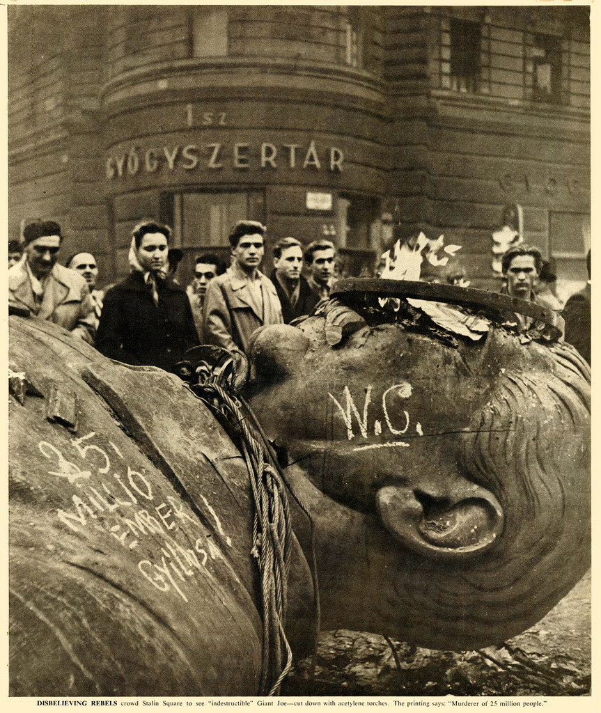 "Hungarian Revolution, 1956   photograph by Sandor Acs. The writing on the left translates as ""The Murderer of 25 Million People""."