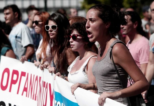 Protesters of the Greek Communist party affiliated unions march in front of the Greek Parliament in Athens Wednesday Sept. 26, 2012. Greek workers walked off the job Wednesday for the first general strike since the country's coalition government was formed in June, as the prime minister and finance minister hammered out a package of euros 11.5 billion ($14.87 billion) in spending cuts. Athens has struggled to come up with more punishing austerity measures that would be acceptable to its rescue creditors, with disagreements arising between the three parties that make up the coalition government. Greece's creditors have demanded more fiscal reforms if they are to continue handing out rescue loans preventing the country from a messy default that could roil the euro. Photo: Nikolas Giakoumidis / AP Read more: http://www.seattlepi.com/news/article/Greek-riots-Spanish-marches-shatter-market-calm-3894362.php#ixzz28w2eWxiD