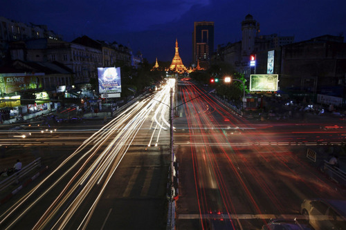 Heavy going in Myanmar's transportation (Photo: Damir Sagolj / Reuters) For more than a century, owners of ox-drawn carts, World War Two-era trucks and decrepit buses have descended on a shrine under a banyan tree in Myanmar's biggest city to bless one of the world's oldest vehicle fleets, dominated by wheezing Japanese rust-buckets from the 1980s or older. Today, as the country emerges from 49 years of isolation, the Shwe Nyaung Pin Nat Shrine has new visitors - freshly minted cars.  Read the complete story.