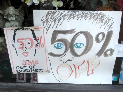 Portrait of a 50% off sale. Photographed this afternoon along N. Milwaukee Avenue in Chicago's Avondale neighborhood.