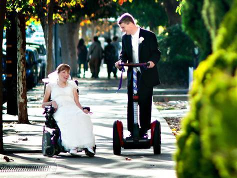 "Wheeled wedding unites couple with cerebral palsy (Photo: Stout Photography) The bride wore white and used a wheelchair; the groom looked handsome as he steered a Segway in his tuxedo. Over the weekend, Melissa Crisp and Owen Cooper had a wedding on wheels. Their wedding invitations asked guests to join them as they ""roll into marriage."" ""We had a roll theme going on,"" Cooper told TODAY.com. ""That was Melissa's wording."" Read the complete story."
