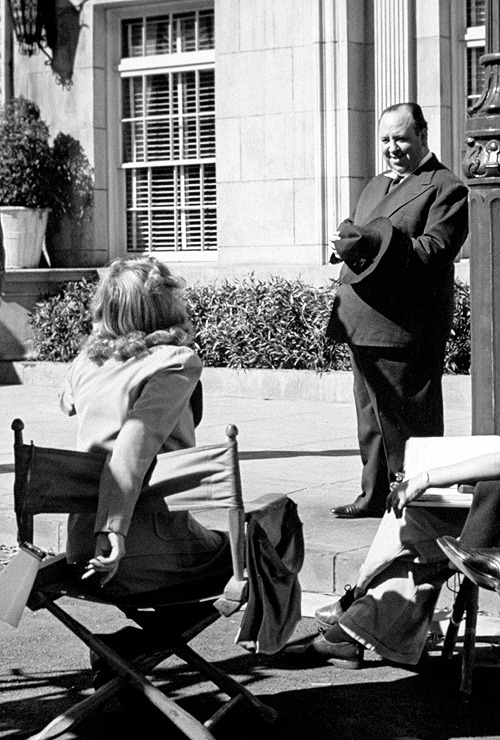 Carole Lombard & Alfred Hitchcock on the set of 'Mr and Mrs Smith', 1941.