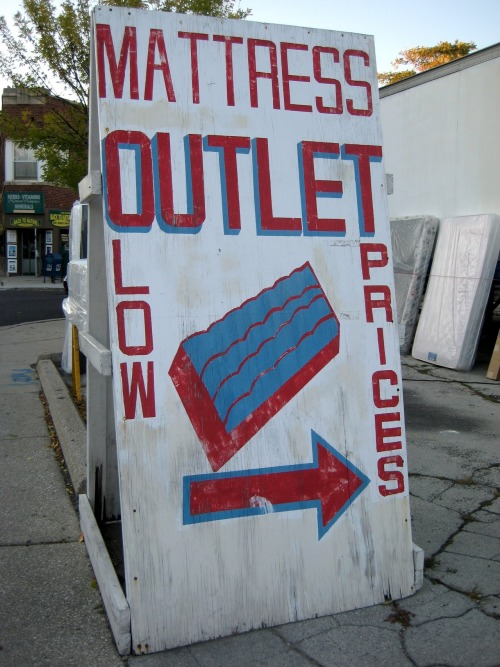 Hand-painted signage from the Mattress Outlet on N. Milwaukee Ave. in Chicago's Avondale neighborhood.