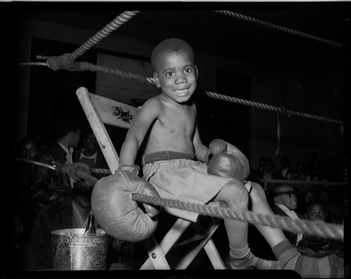 "I'm The Greatest of All Time!!! | 1948 Little child boxer, seated in fighting ring, presumably in Kay Boys' Club, Pittsburgh, PA circa 1945. Charles ""Teenie"" Harris Collection, Courtesy of Carnegie Art Museum. FIND US ON TWITTER 