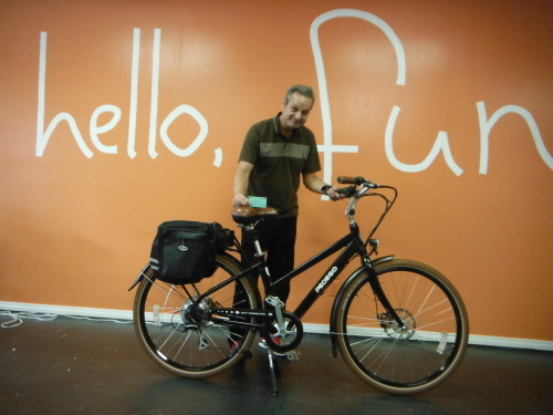 tlandre:  I did it! I picked up my new bike from PEDEGO Coronado.  The guys at the PEDEGO store had the bike all ready for me and added a bunch of extras like panniers, a tire pump and an alarm. Yes, alarm. They also pledged their support of my journey over the next year and will be providing any maintenance or repairs if needed. I completely appreciate that kind of thing. Took the Coronado ferry back to downtown San Diego so I could experience the bike ride home from work. I work downtown. I felt like everyone on the ferry knew that I had traded my car for a bike. It was understood. No need to talk about it.  My goal was to make it home in an hour. I made it home in an hour. It worked. The electric assist feature is magic. It did exactly what I wanted it to do, assist me on the hills. I need to fine tune my route a bit but am confident that I made the right decision to trade my car.